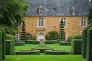 The manor house surrounded by topiary in Les Jardin du Manoir D'Eyrigniac in Salignac, Dordogne, France