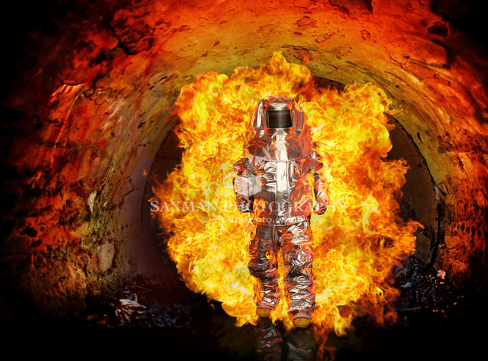 Man in fire proximity suit with fireball
