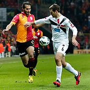 Galatasaray's Hamit Altintop (L) and Genclerbirligi's Ante Kulusic (R) during their Turkish Super League soccer match Galatasaray between Genclerbirligi at the TT Arena at Seyrantepe in Istanbul Turkey on Friday, 08 March 2013. Photo by Aykut AKICI/TURKPIX