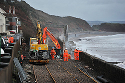 © Licensed to London News Pictures. Date 07/02/2014. Dawlish, UK. Workmen carrying out limited repairs to the seafront and railway lines at Dawlish, Devon ahead of more expected tidal storm weather today (08/02/2014). Photo credit : Mark Hemsworth/LNP