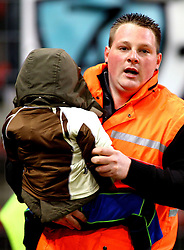 12.03.2011, Stade du Pays, Charleroi , BEL, JL,  Sporting Charleroi vs Standard Liège, im Bild Charleroi 's steward saved a child as supporters try to storm the pitch  during Jupiler Pro League Season 2010 - 2011 soccer match R Charleroi SC and  Standard. Saterday Mar. 12, 2011.  EXPA Pictures © 2011, PhotoCredit: EXPA/ nph/  Alain Sprimont       ****** out of GER / SWE / CRO  / BEL ******