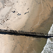 """The US/Mexico border at the southern most point where it enters the Pacific Ocean at Imperial Beach, CA. For more images, search for """"immigration by air and sea"""". Please contact Todd Bigelow directly with your licensing requests."""