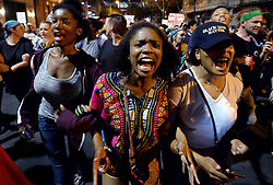 September 23, 2016 - Charlotte, NC, USA - Protesters chant ''Black Lives Matter'' as they march throughout the city of Charlotte, N.C., on Friday, Sept. 23, 2016, as demonstrations continue following the shooting death of Keith Scott by police earlier in the week. (Credit Image: © Jeff Siner/TNS via ZUMA Wire)