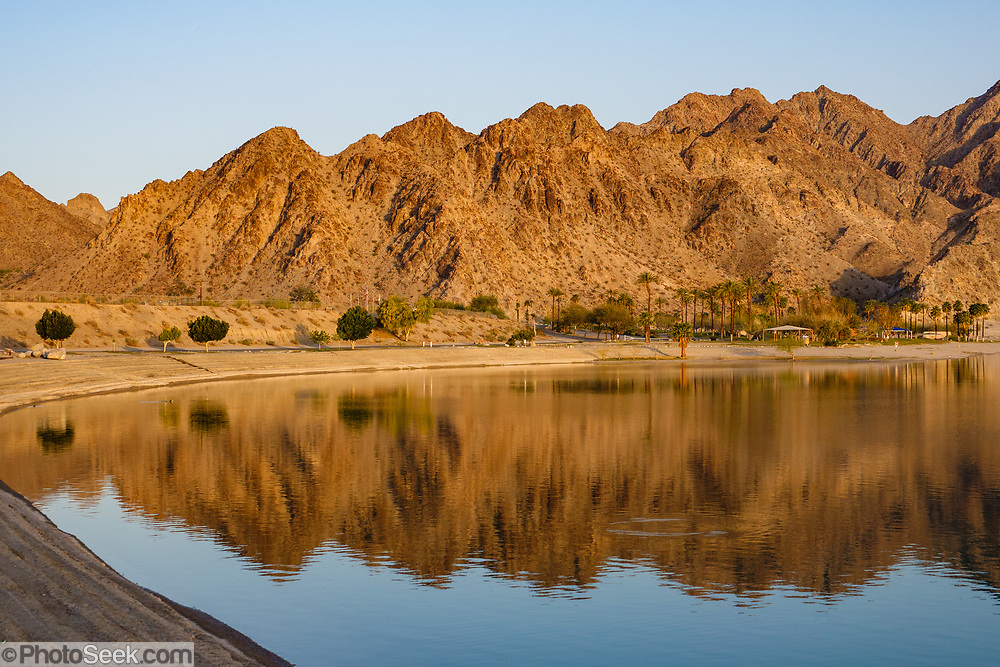 San Jacinto Mountains reflect in Lake Cahuilla Veterans Regional Park Campground, La Quinta, California, USA.
