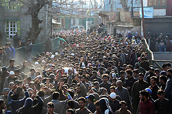 March 22, 2019 - Bandipora, Kashmir, 22nd March 2019. A large crowd attend the funeral procession of 11-years-old Atif Mir who was killed during a gun battle between Indian Government forces and suspected foreigner militants in the Hajin area of the Bandipora district in Indian Administered Kashmir on Friday. Eight rebels were killed by the Indian government forces during 4 separate gunfights across Kashmir on Friday. Two foreign militants and the 11-years-old boy were also killed during one encounter. Police has stated that Atif was killed after he was allegedly kept hostage by militants during a gunfight. According to official sources, a cordon and search operation had been launched by police and security forces in the Hajin area of North Kashmir's Bandipora district, following  information about the presence of militants in the area. Several residential houses were also damaged in the confrontations (Credit Image: © Muzamil Mattoo/IMAGESLIVE via ZUMA Wire)