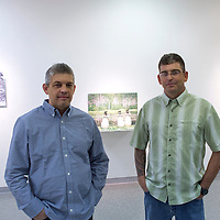 110414     Cayla Nimmo<br /> <br /> Brothers Jason, left, and Jeff Hackett pose for a photo inside the Ingham Chapman Gallery at the University of New Mexico's Gallup campus n Tuesday where their collaboration work will be showcased until December 5.