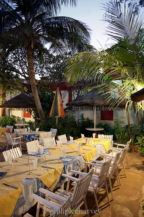 A dinner table laid in the garden of a hotel in Segou, Mali