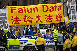 © Licensed to London News Pictures . 23/10/2015 . Manchester , UK . Falun Dafa ( Falun Gong ) protest opposite Manchester Town Hall as Chinese president , Xi Jinping visits Manchester as part of his state visit to the United Kingdom . Photo credit: Joel Goodman/LNP