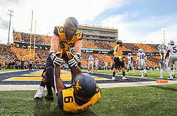 Sep 22, 2018; Morgantown, WV, USA; West Virginia Mountaineers offensive lineman Colton McKivitz (53) helps West Virginia Mountaineers running back Kennedy McKoy (6) after a play near the end zone during the second quarter against the Kansas State Wildcats at Mountaineer Field at Milan Puskar Stadium. Mandatory Credit: Ben Queen-USA TODAY Sports