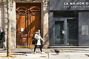 """March, 27th 2020 - Paris, Ile-de-France, France: Paris under confinement, Avenue Montaigne area of high fashion, beauty, accessories, haute couture, all shops closed, in 8th arrondissement, and all public spaces virtually empty to stop the spread of the Coronavirus, during the eleventh day of near total lockdown imposed in France. The President of France, Emmanuel Macron, said the citizens must stay at home for at least 15 days, that has been extended. He said """"We are at war, a public health war, certainly but we are at war, against an invisible and elusive enemy"""". All journeys outside the home unless justified for essential professional or health reasons are outlawed. Anyone flouting the new regulations is fined. Nigel Dickinson"""