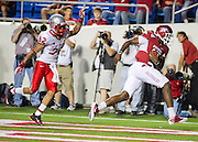 Sep 10, 2011; Little Rock, AR, USA; Arkansas Razorback Brandon Mitchell (17) gets past New Mexico Lobos defensive back DeShon Marman (32) to score a touchdown during the second half at War Memorial Stadium. The Razorbacks beat the Lobos 52-3. Mandatory Credit: Beth Hall-US PRESSWIRE