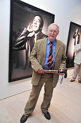 TREVOR BAYLIS at an exhibition of photographic portraits by Bryan Adams entitled 'Hear The World' at The Saatchi Gallery, King's Road, London on 21st July 2009.