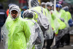 © Licensed to London News Pictures. 26/08/2018. London, UK. Carnival stewards brave the wet and windy conditions at family day of the 2018 Notting Hill Carnival. Up to 1 million people are expected to attend this weekend's event that is one of the worlds largest street festivals. Photo credit: Ben Cawthra/LNP