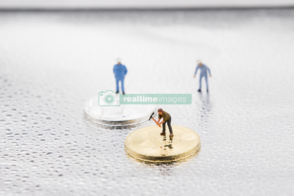 August 4, 2017 - Unspecified, Italy - A view of Bitcoin token and a miner miniature figures. Bitcoin is a cryptocurrency and a digital payment system invented by an unknown programmer, or a group of programmers, under the name Satoshi Nakamoto. It was released as open-source software in 2009. (Credit Image: © Manuel Romano/NurPhoto via ZUMA Press)