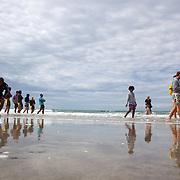 Players walk on the foreshore during the Australian teams recovery session at  Takapuna Beach at the IRB Rugby World Cup tournament, Auckland, New Zealand, 17th October 2011. Photo Tim Clayton...