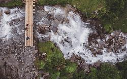 THEMENBILD - Wanderer auf einer Bruecke ueber einem Bergbach waehrend einer Wanderung entlang des Wasserfallweges, aufgenommen am 28. Juli 2019 in Fusch a. d. Grossglocknerstrasse, Oesterreich // Hikers on a bridge over a mountain stream during a hike along the waterfall trail in Fusch a. d. Grossglocknerstrasse, Austria on 2019/07/28. EXPA Pictures © 2019, PhotoCredit: EXPA/ JFK