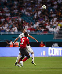 July 31, 2018 - Miami Gardens, Florida, USA - Real Madrid C.F. forward Karim Mostafa Benzema (9) and Manchester United F.C. defender Eric Bailly (3) anticipate a header during an International Champions Cup match between Real Madrid C.F. and Manchester United F.C. at the Hard Rock Stadium in Miami Gardens, Florida. Manchester United F.C. won the game 2-1. (Credit Image: © Mario Houben via ZUMA Wire)