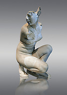 Aphrodite Crouching whilst bathing. The Goddess of love Aphrodite, Venus to the Romans is depicted crouching whilst bathing, she looks to one side as if surprised by something. In this style of Aphrodite statue her arms stretch across in front of her and her right hand gently touches her right shoulder. This statue is a  2nd century Roman copy of a lost Greek. Hellanistic original of the mid 3rd century BC attributed to the Greek sculptor Doldalsas of Bethynia. This version of Aphrodite Bathing made around AD 117-138 is the most artistically successful version know. Capitoline Museums, Rome