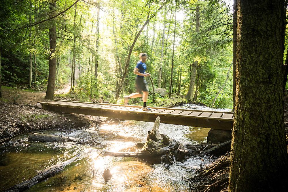Runners participate in the half-marathon trail run event during Marquette Trails Fest.
