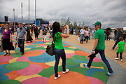 London 2012 Olympic Park in Stratford, East London. Coloured walkway which is soft and child friendly. Both kids and adults find themselves walking on specific colours.