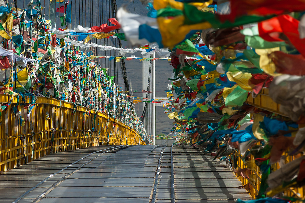 Bridge covered with prayer flags near Lhasa, Tibet, China. Photo © robertvansluis.com
