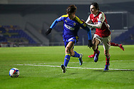 AFC Wimbledon attacker Ryan Longman (29) battles for possession with Arsenal defender Joel Lopez (49) during the EFL Trophy match between AFC Wimbledon and U21 Arsenal at Plough Lane, London, United Kingdom on 8 December 2020.