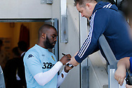 Leeds United striker Souleymane Doukara (11) signs autographs during the EFL Sky Bet Championship match between Burton Albion and Leeds United at the Pirelli Stadium, Burton upon Trent, England on 22 April 2017. Photo by Richard Holmes.
