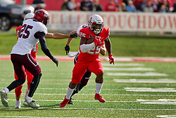 NORMAL, IL - October 13: James Robinson sprints past Madre Harper and Michael Elbert thanks to some timely blocking from Andrew Edgar during a college football game between the ISU (Illinois State University) Redbirds and the Southern Illinois Salukis on October 13 2018 at Hancock Stadium in Normal, IL. (Photo by Alan Look)