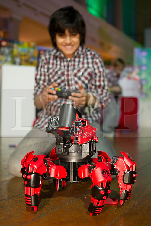© Licensed to London News Pictures. 31/10/2012. London, UK. 11 year old Dillon Mitra controls a WowStuff 'Attacknid' robot (RRP GB£69.99) in London today (31/10/12) as the Toy Retailers Association releases its 13 Dream Toys for Christmas 2012. Photo credit: Matt Cetti-Roberts/LNP