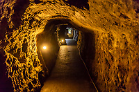Ryugenji Mabu Mine Shaft at Iwami Ginzan - Ryugenji-mabu is one of the few mine tunnels open to public. Chisel marks show the traces that the miners made to scrape tunnels by hand.  Ryugenji Mabu Mine Shaft was built in 1715.  Although Ryugenji-Mabu is only one of the more than 500 shafts and galleries that had originally been dug, it is the most accessible to visitors.  Iwami Ginzan flourished between 1500 and 1700 as an active silver mine and was fought over by many rulers in the area but came under strict control around the end of the Tokugawa Shogunate. At one point, Japan produced a third of the worldís silver, and most of this was mined by at Iwami Ginzan. Silver from Iwami was exported overseas and it played a large role in supporting trade between Europe and Asia.  Around the mine are merchant and samurai houses which date back to the time when the mine was active.