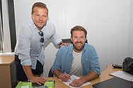 Scott Laird becomes the latest Forest Green Rovers Signing pictured with manager Mark Cooper at the New Lawn, Forest Green, United Kingdom on 20 June 2017. Photo by Shane Healey.