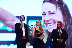 Gracie Elvin (AUS) receives Van Vleuten's award for UCI Women's WorldTour winner at The UCI Cycling Gala 2018 in Guilin, China on October 21, 2018. Photo by Sean Robinson/velofocus.com