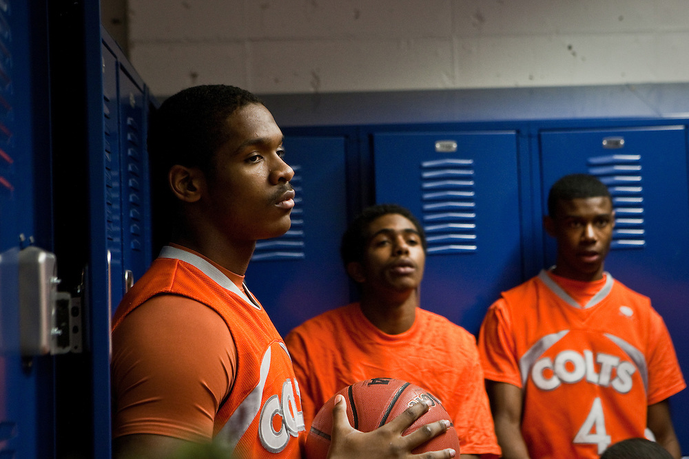 Coolidge High School basketball players listen to their coach in the locker room before a game against DeMatha Catholic High School in Hyattsville, MD.