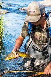 Green River fly-fisher with a nice brown trout.
