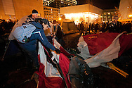 Boston, MA 12/08/2011.Occupy Boston protestors pack up a tent at Dewey Square on Thursday night..Alex Jones / www.alexjonesphoto.com