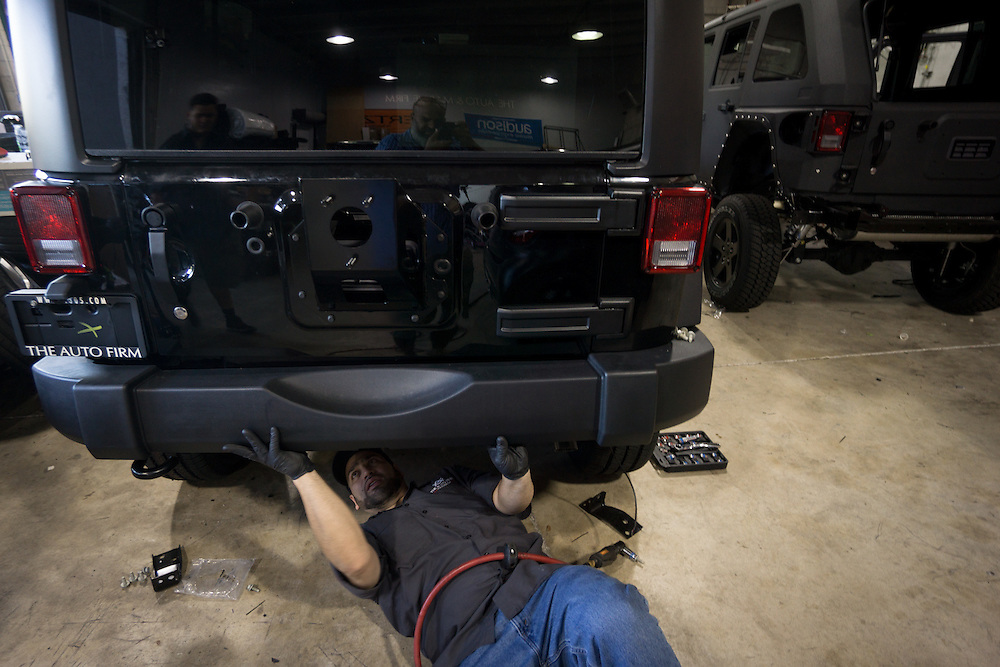 DORAL, FLORIDA, DECEMBER 11, 2015<br /> Arael Velazquez, removes a factory bumper from a Jeep Wrangler to replace it with a kit one as he customizes the vehicle in the garage of The Auto Firm, a South Florida car customizing and restoring shop which has a vast clientele of professional athletes and entertainers.<br /> (Photo by Angel Valentin/Freelance)