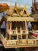02 NOVEMBER 2016 - BANGKOK, THAILAND:  A nearly completed spirit house in the workshop. There used to be 10 families making traditional spirit houses out of teak wood in Ban Fuen, a community near Wat Suttharam in the Khlong San district of Bangkok. The area has been gentrified and many of the spirit house makers have moved out, their traditional wooden Thai houses replaced by modern apartments. Now there is just one family making the elaborate spirit houses. The spirit houses are made by hand. It takes three days to make a small one and up to three weeks to make a large one. Prices start at about $90 (US) for a small one. The largest, most elaborate ones can cost over $1,000 (US). Almost every home and most commercial buildings in Thailand have a spirit house, which is a shrine to the protective spirit of a the land. Spirit houses are also common in Burma, Cambodia, and Laos.       PHOTO BY JACK KURTZ