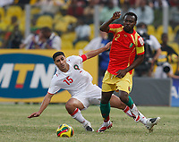 Photo: Steve Bond/Richard Lane Photography.<br />Guinea v Morocco. Africa Cup of Nations. 24/01/2008. Pascale Feindounou (R) is tackled by Youssef Safri (L)