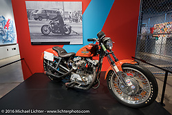 Lonnie Isam's Orange Crush Ironhead Sportster set 11 records while testing the original S&S Super D carburetor between 1975-1980. It has the final prototype of the Super D as it sits on display in Drag Racing: America's Fast Time exhibition at the Harley-Davidson Museum during the Milwaukee Rally. Milwaukee, WI, USA. Saturday, September 3, 2016. Photography ©2016 Michael Lichter.