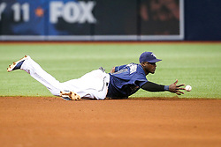 July 8, 2017 - St. Petersburg, Florida, U.S. - WILL VRAGOVIC       Times.Tampa Bay Rays shortstop Adeiny Hechavarria (11) knocks down the liner by Boston Red Sox catcher Sandy Leon (3) to end the top of the fifth inning of the game between the Boston Red Sox and the Tampa Bay Rays at Tropicana Field in St. Petersburg, Fla. on Saturday, July 8, 2017. (Credit Image: © Will Vragovic/Tampa Bay Times via ZUMA Wire)