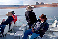 Visitors to Rainbow Bridge National Monument travel several hours by boat on Lake Powell, walk across a floating dock and then hike 1/2 mile to the 290' high natural arch, Wednesday, March 12, 2003.  Tourists to the most popular spot on Lake Powell used to boat within sight of the monument.