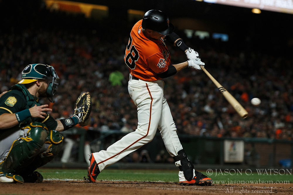 SAN FRANCISCO, CA - JULY 13: Buster Posey #28 of the San Francisco Giants hits an RBI double against the Oakland Athletics during the seventh inning at AT&T Park on July 13, 2018 in San Francisco, California. The San Francisco Giants defeated the Oakland Athletics 7-1. (Photo by Jason O. Watson/Getty Images) *** Local Caption *** Buster Posey
