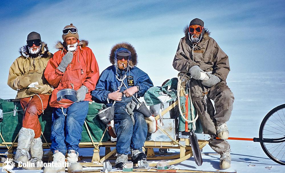 NZARP dog sledging lunch-break, head of Shackleton Glacier, December 1961 - L to R: Geologist Vic McGregor, surveyor Peter Otway, mountaineer Kevin Pain, surveyor-artist-dog handler Wally Herbert.
