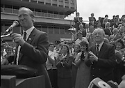 Irish Soccer Team Welcomed Home.   (R81)..1988..19.06.1988..06.19.1988..19th June 1988..After their great success in Germany in Euro 88, the Irish soccer team had a triumphant homecoming. An Taoiseach, Charles Haughey TD and his government were to the forefront of the welcome. Thousands of fans thronged the airport and all the approach roads in the hope of seeing the team. The full squad is as follows..1.GK.Packie Bonner. Celtic.2.DF.Chris Morris. Celtic.3.DF.Chris Hughton  Tottenham Hotspur.4.DF.Mick McCarthy. Celtic.5.DF.Kevin Moran. Manchester United.6.MF.Ronnie Whelan. Liverpool.7.MF.Paul McGrath. Manchester United.8.MF.Ray Houghton. Liverpool.9.FW.John Aldridge. Liverpool.10.FW.Frank Stapleton Derby County.11.MF.Tony Galvin. Sheffield Wednesday.12.FW.Tony Cascarino. Millwall.13.MF.Liam O'Brien. Manchester United.14.FW.David Kelly. Walsall.15.MF.Kevin Sheedy. Everton.16.GK.Gerry Peyton. Bournemouth.17.FW.John Byrne. Le Havre.18.FW.John Sheridan. Leeds United.19.DF.John Anderson. Newcastle United.20.FW.Niall Quinn. Arsenal..Image shows the  An Taoiseach,Charles Haughey TD,applauding Jack Charlton. The team and FAI officials are arranged on the platform behind.