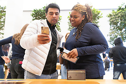 © Licensed to London News Pictures. 20/09/2019. London, UK. An Apple staff member with a customer completes a purchase for the new iPhone 11 mobile phone Photo credit: Ray Tang/LNP