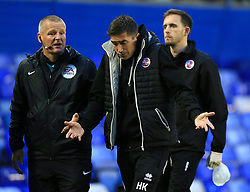 Crawley Town's manager Harry Kewell walks off dejected at half time