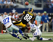 Dallas Cowboys strong safety Eric Frampton (27) and free safety Gerald Sensabaugh (43) break up a pass intended for Pittsburgh Steelers wide receiver Emmanuel Sanders (88) at Cowboys Stadium in Arlington, Texas, on December 16, 2012.  (Stan Olszewski/The Dallas Morning News)