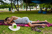 12 SEPTEMBER 2003 - CANCUN, QUINTANA ROO, MEXICO:  An anti-WTO protester sleeps in a park in Cancun. Tens of thousands of protesters, mostly farmers, came to Cancun for the fifth ministerial of the World Trade Organization (WTO). They were protesting against developed nations pushing to get access to agricultural markets in developing nations. The talks ultimately collapsed after no progress with no agreements reached between the participants.          PHOTO BY JACK KURTZ