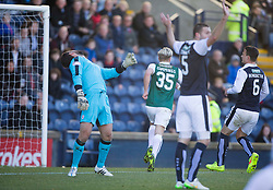 Hibernian's Jason Cummings scoring their second goal over Raith Rovers keeper Kevin Cuthbert. <br /> Half time : Raith Rovers 0 v 1 Hibernian, Scottish Championship game played 24/10/2015 at Starks Park.