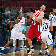 Anadolu Efes's Terence KINSEY (L) and Olympiacos's Matthew HOWARD (C) during their Two Nations Cup basketball match Anadolu Efes between Olympiacos at Abdi Ipekci Arena in Istanbul Turkey on Sunday 02 October 2011. Photo by TURKPIX